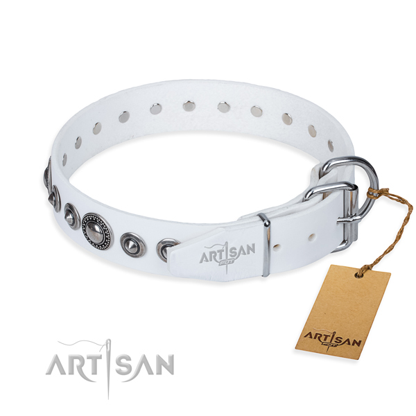 Natural genuine leather dog collar made of gentle to touch material with corrosion resistant embellishments